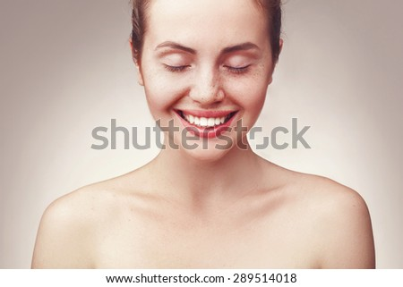 Shutterstock Close up portrait of beautiful young happy smiling woman wiht closed eyes, isolated over light grey background