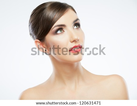 Close up portrait of beautiful young woman face. Isolated on white background. Portrait of a female model. Hand on face