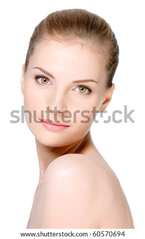 Close-up portrait of beautiful young woman with healthy clean skin on a face - isolated