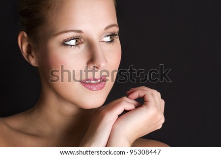 Close-up portrait of beautiful  young woman with healthy skin on a face.