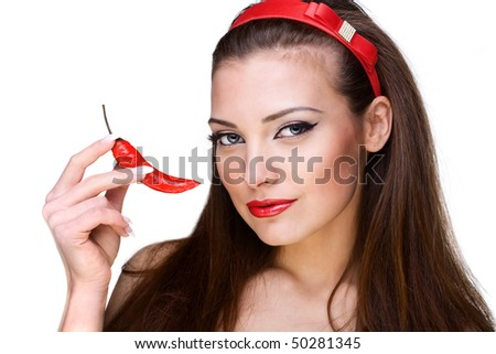 Close-up portrait of beautiful young woman with pepper