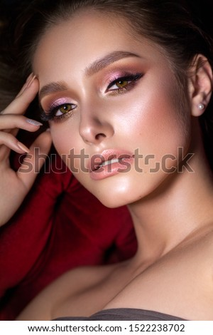 Close up portrait of beautiful young woman with professional makeup, perfect skin, trendy colorful eyeshadows.