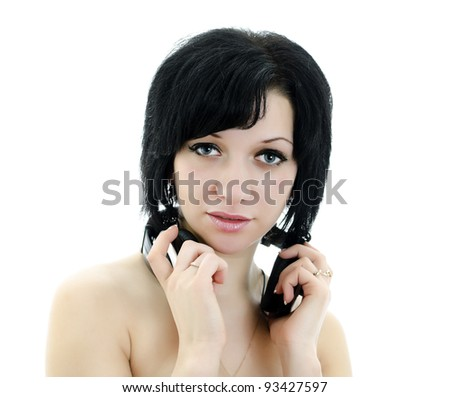Close-up portrait of brunette woman with headphones, isolated over white background