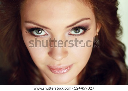 Close-up portrait of caucasian young woman