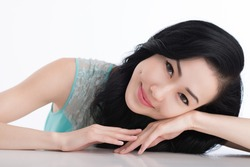 Close-up portrait of charming Asian girl with dimples on her cheeks