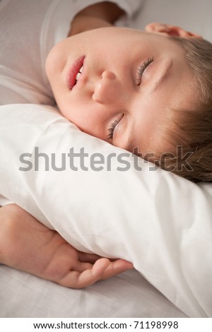 Close up portrait of charming sleeping boy - stock photo