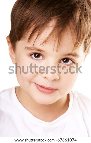 Close-up portrait of charming smiling little boy isolated on white background