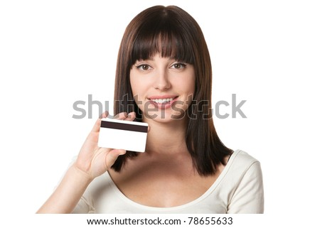 Close-up portrait of cheerful female holding credit card isolated on white background