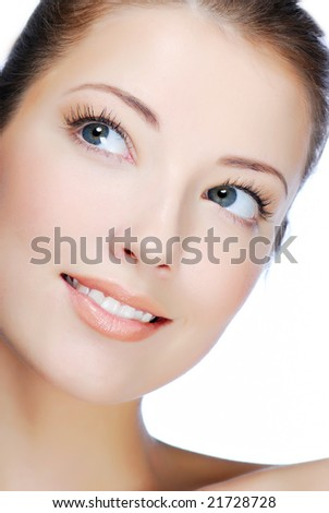 Close-up portrait of cheerful young adult girl - looking up