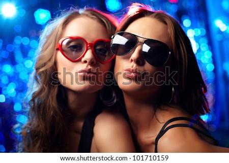Close-up portrait of cool girls at nightclub