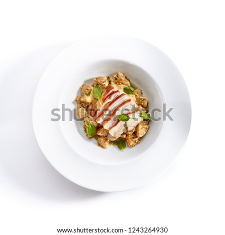 Close-up portrait of cream potato with pork slices. Studio picture of delicious dish served on plate. Restaurant meal concept. Isolated on white background