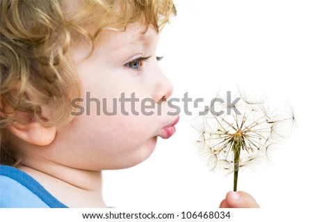 Close-up Portrait of cute Child with dandelion in profile - stock photo