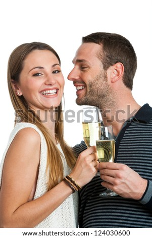Close up portrait of cute couple making a toast with sparkling wine. Isolated on white.