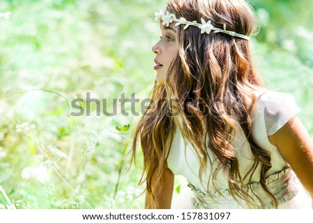 Close up portrait of cute girl in green field. - stock photo