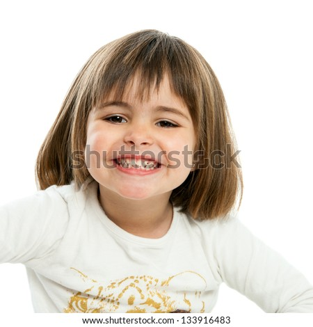 Close up portrait of cute girl showing teeth. Isolated on white.