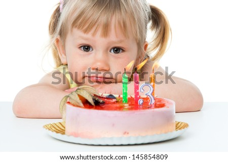 Close up portrait of cute girl with birthday cake.Isolated on white. - stock photo