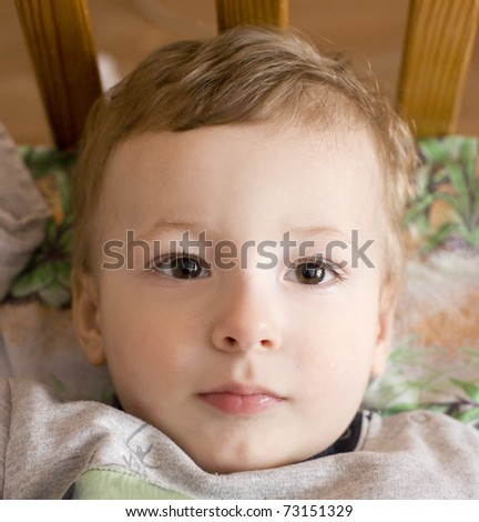 close up portrait of cute little boy in bed