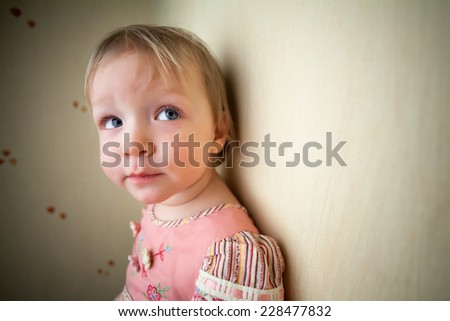 Close-up portrait of cute pensive girl