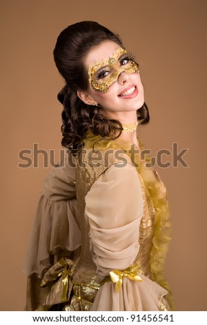 close up portrait of elegant girl with a mask painted on her face - stock photo