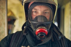 Close up portrait of face firefighter wearing protective uniform and an protective mask