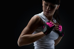 Close up portrait of fitness athletic young woman in sports clothing showing her well trained body