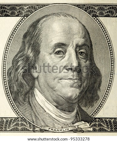 close-up portrait of Franklin with hundred dollar bills