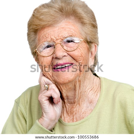 Close up portrait of friendly senior woman.Isolated on white.