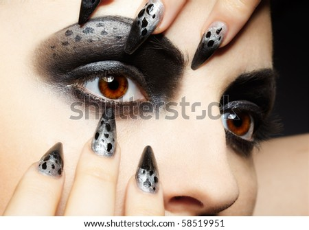 close-up portrait of girl's eye-zone bodyart