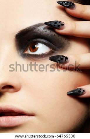 close-up portrait of girl's eye-zone bodyart