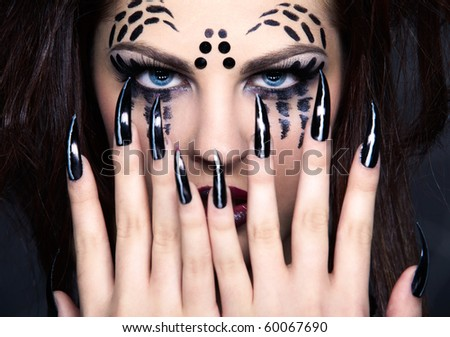 close up portrait of girl with spider bodyart of face zone and black finger-nails