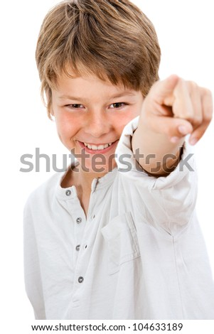 Close up Portrait of handsome boy pointing at you.Isolated on white.