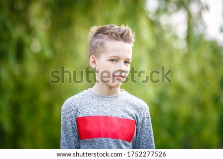 close up portrait of handsome boy teenager in green background Stockfoto ©