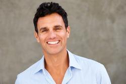 Close up portrait of handsome casual businessman smiling