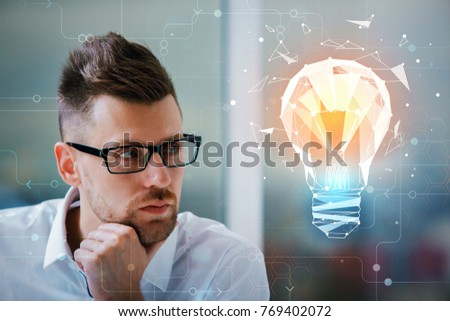 Close up portrait of handsome european businessman with glasses looking at glowing polygonal lamp on blurry background. Tech and infograph concept. Double exposure  #769402072