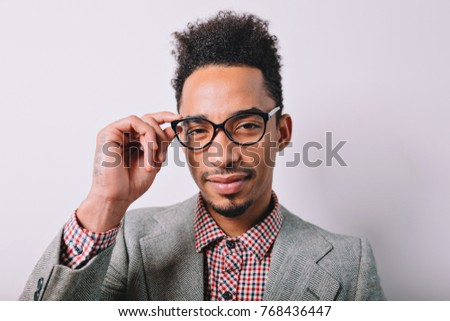 80f5e9005903 Close-up portrait of handsome modern black guy wears stylish glasses and  grey suit posing