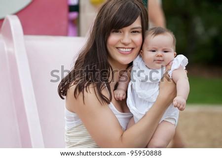 Close-up portrait of happy mother with her adorable daughter