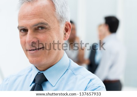 Close-up Portrait Of Happy Senior Businessman in His Office