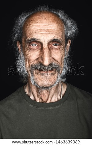 close-up portrait of happy senior man with gray hair, beard and moustache posing to the camera. isolated black background. studio shot.happiness, feeling and emotion, homeless person #1463639369