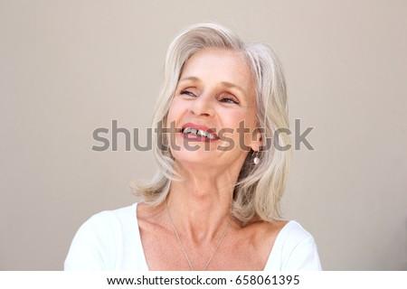 Close up portrait of happy senior woman smiling  #658061395