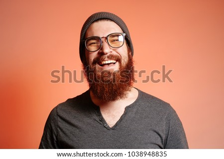 Close up portrait of happy smiling bearded hipster man with eyeglasses and looking confident at the camera #1038948835