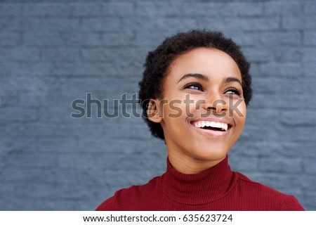 Close up portrait of happy young black woman laughing  - Shutterstock ID 635623724