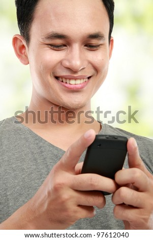 close up portrait of happy young man reading a message