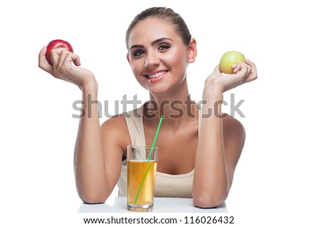 Close-up portrait of happy young woman with apple juice on white background. Concept vegetarian dieting - healthy food