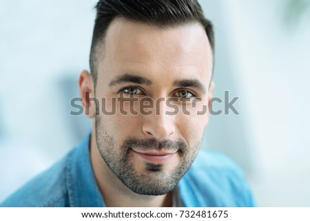 Close up portrait of hazel eyed gentleman in casual