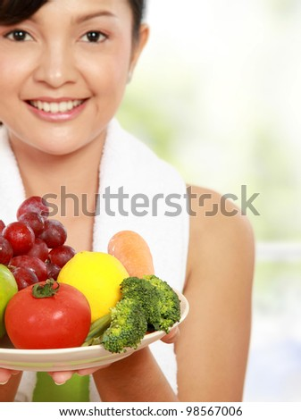 close up portrait of healthy fitness woman carrying a group of healthy food