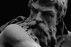 Close up portrait of Hephaestus. In Greek and Roman mythology god of the forge and blacksmiths. Fragment of an ancient statue.