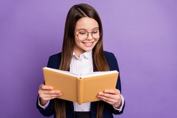 Close-up portrait of her she lovely focused brainy long-haired pre-teen girl schoolchild reading home task homework diary isolated bright vivid shine vibrant lilac violet color background