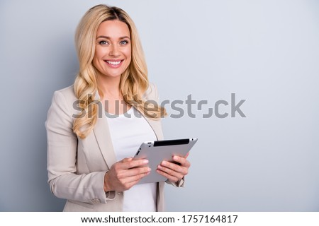Close-up portrait of her she nice attractive charming skilled cheerful wavy-haired lady holding in hands using tablet finance hr it market research isolated on light white gray pastel color background