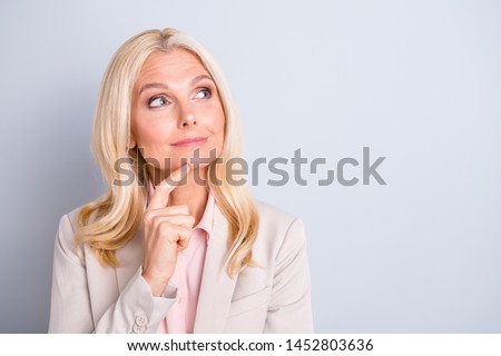 Close-up portrait of her she nice attractive charming stylish focused wavy-haired lady executive assistant director creating plan touching chin isolated over light white gray pastel background