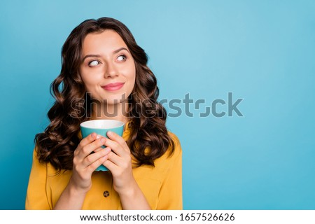 Close-up portrait of her she nice attractive cheery dreamy curious feminine wavy-haired girl holding in hands drinking latte isolated on bight vivid shine vibrant green blue turquoise color background Foto stock ©